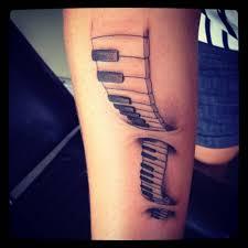 ripped skin piano keys tattoo design on forearm golfian com