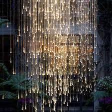 outdoor string lights rain spectacular light installations by bruce munro longwood gardens
