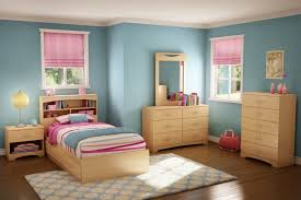 blue kids bedroom paint color with pinewood furnishing and dotted