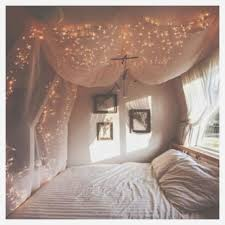 bedroom compact fairy lights painted wood wall and pink