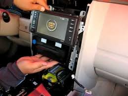 how to remove radio cd changer navigation from 2004 to 2009