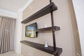 home interior design tv shows interior design of home with tv and shelving stock photo