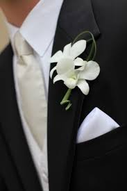 orchid boutonniere boutonniere featuring white dendrobium orchids and grass