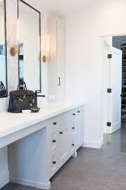 thin black frame vanity mirror with light gray washstand