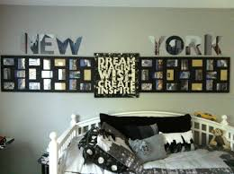 addy s broadway style room with a new york theme two large photo broadway style room with a new york theme two large photo frames turned sideways to display photos canvas sign in between and letter stickers of new york