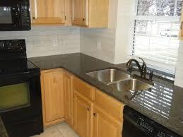 Backsplash Ideas With Dark Granite Countertop by Kitchen Wide Plank Floors Glazed Subway Backsplash Simple Cabinets