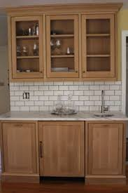 elegantly simple modern craftsman style kitchen cabinets shown