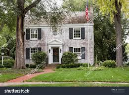 white brick georgian colonial house flagpole stock photo 486387067