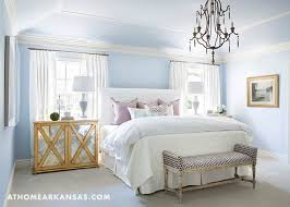 white and blue bedroom with gold leaf mirrored nightstands