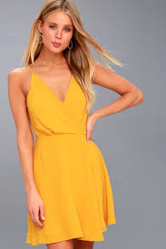 yellow dress pretty golden yellow backless dress yellow surplice dress