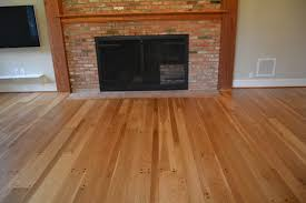 random width white oak floors with walnut pegs refinished with