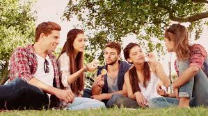 in motion happy friends in the park picnic on a