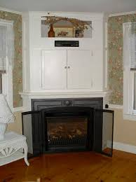 classic corner fireplace designs ideas with tv above corner