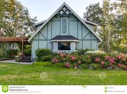 Big Farm House by Big Farmhouse With Beautiful Flowerbed Royalty Free Stock Photo