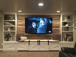 our hand crafted entertainment center built in with 75 yr old