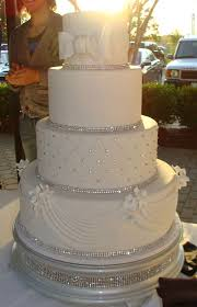 wedding cakes near me the rhinestones around the bottom of each tier but i
