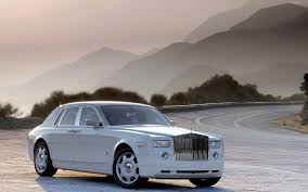 roll royce ghost white rolls royce phantom white road mountain sun nature hd wallpaper