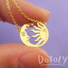 sun and crescent moon celestial pendant necklace in gold dotoly