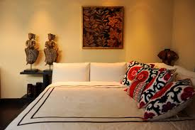 queen daybed bedroom contemporary with floral pillows corner bed