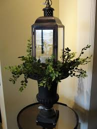 lantern atop an urn with greenery o i have one like this and i