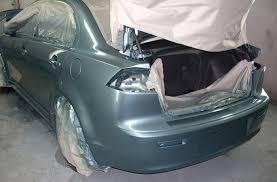 How To Spray Paint Your Car - mccarthy u0027s garage inc barbados body repairs spray painting