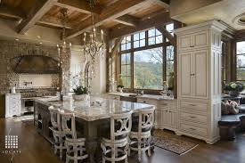 country kitchen with large island and rustic ceiling kitchens