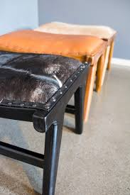 Cowhide Chairs And Ottomans Marlboro Layback Chair And Footstool Black And White Cowhide