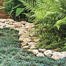 Rocks For Garden Edging This Rock Border Put A Barrier Cardboard