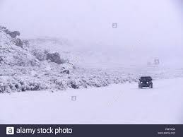 jeep utah jeep driving in a snow storm in utah usa stock photo royalty free