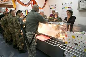 u s army soldiers in kosovo are served a thanksgiving meal amid