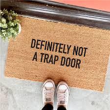 funny doormats mat of the week the definitely not a trap door doormat