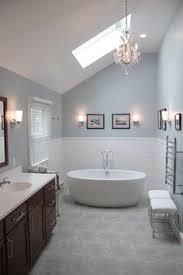 solitude by benjamin moore looks amazing in this bathroom designed