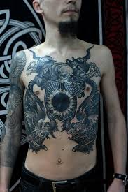 gorgeous with a skull black sun and the mythical bird