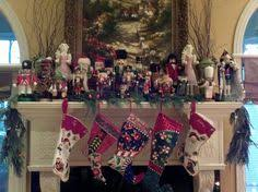 nutcracker collection on mantle with colored lights and live