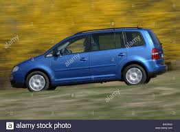 car volkswagen side view car vw volkswagen touran tdi van model year 2003 blue moving