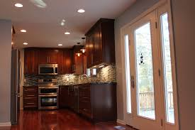 brown wooden kitchen cabinets brown wooden floor gas stove and