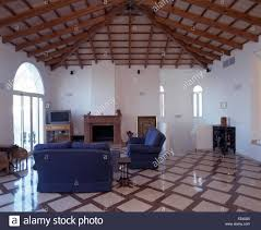 spanish floor ceramic tiled floor and ceiling with criss cross beams in white