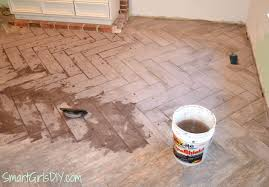 Floor Up by Grouting A Herringbone Tile Floor Family Room 11