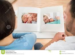 baby album looking at baby s photo album stock photo image 55344854