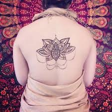 amazing henna lotus tattoo on upper back