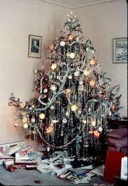 the of a 1950s tree covered with tinsel just