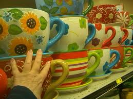 i love these giant coffee cup planters my hand is there 4