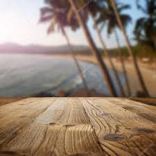 wooden table on the beach with palms u2014 stock photo zoomteam