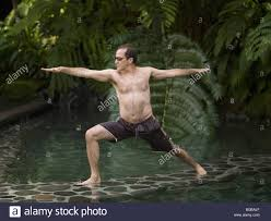 como shambhala estate bali indonesia man in yoga position stock