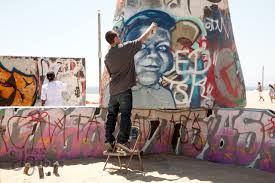 venice beach ca jess gibbs photography two artists work on the ever changing public graffiti walls on the beach spray
