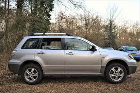 mitsubishi 2004 used mitsubishi outlander 2 4 mivec equippe auto 5 doors 4x4 for