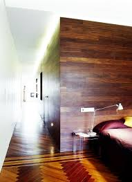 wooden laminate on wall decoration in bedroom design with brown