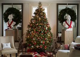day 6 pretty christmas trees traditional home flanking the exquisitely traditional tree are two founding fathers wreaths framing the busts and twig deer