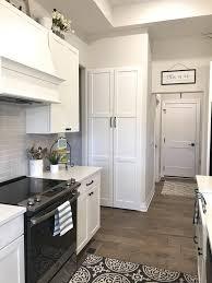 black kitchen cabinets farmhouse farmhouse kitchen white cabinets and black hardware leave