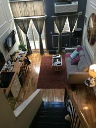 two story loft room with pull out sleeper sofa and queen bed in